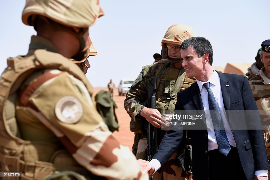 France Prime Minister Manuel Valls salutes a soldier during his visit to the troops of France's Barkhane counterterrorism operation in Africa's Sahel...