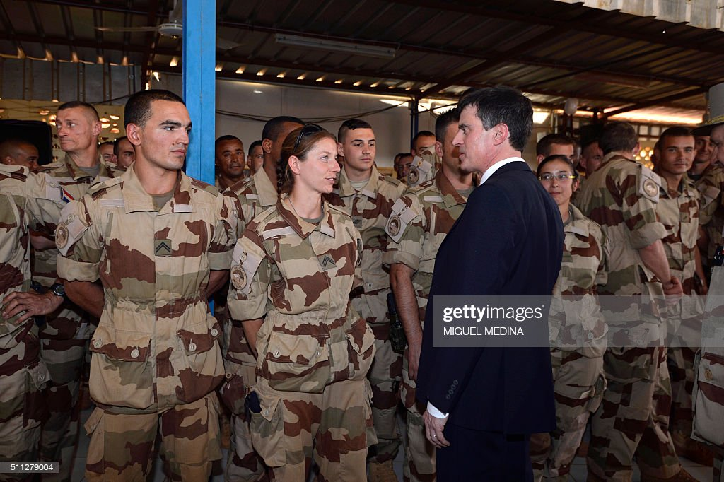France Prime Minister Manuel Valls speaks with officers and soldiers during his visit to the troops of France's Barkhane counterterrorism operation...