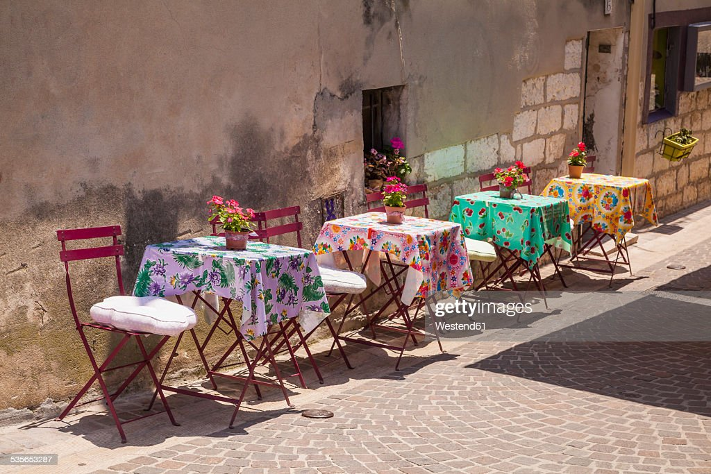 France, Provence-Alpes-Cote dAzur, Bouches-du-Rhone, Cassis, Tables in an alleyway