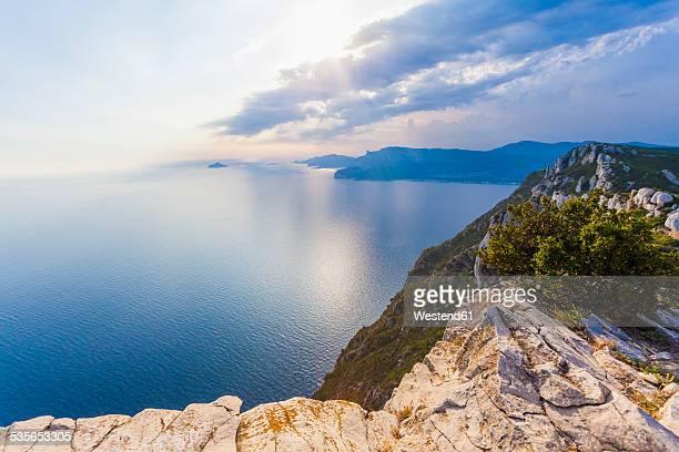 France, Provence-Alpes-Cote dAzur, Provence, Mediterranean coast, near La Clotat and Cassis, Corniche des Cretes, Cliff line against the sun