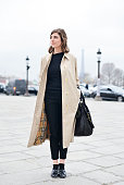 France Rives poses wearing a Burberry trench and a Vanessa Bruno bag on Day 8 of Paris Fashion Week Womenswear FW15 on March 10 2015 in Paris France