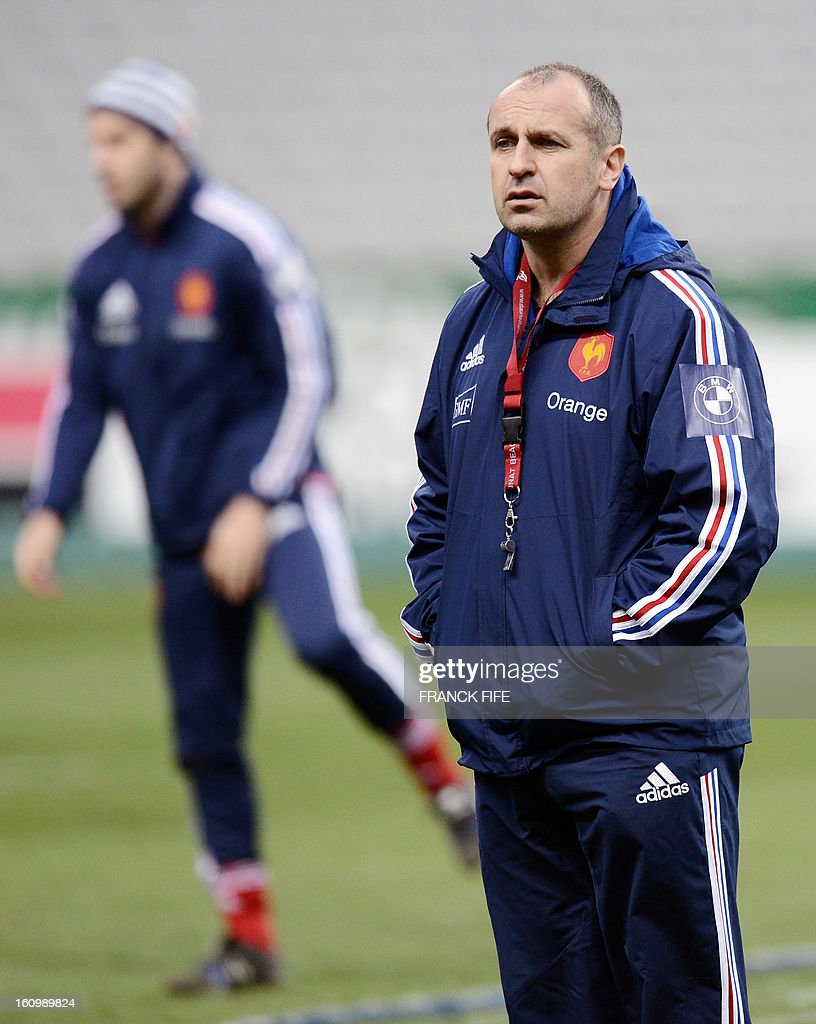 France rugby union national team head's coach Philippe Saint Andre (L) looks as his players during a training session, on February 8, 2013 at the Stade-de-France in Saint-Denis, north of Paris, on the eve of the rugby union 6 Nations tournament match against Wales.