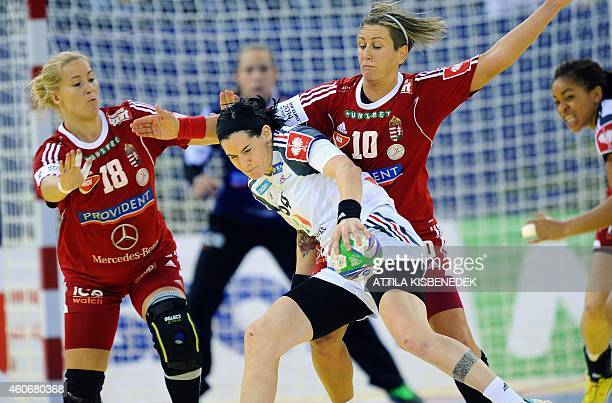 France 's Alexandra Lacrabere fights for the ball with Hungary's Piroska Szamoransky and Anita Bulath in Papp Laszlo Arena of Budapest on December 19...