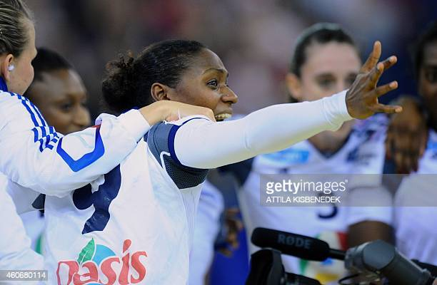 France 's Paule Baudouin celebrates victory in Papp Laszlo Arena of Budapest on December 19 2014 during their 5th place match of Women's European...