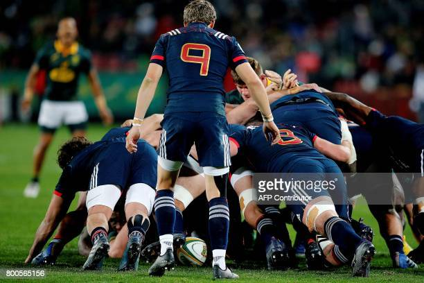 CORRECTION France scrumhalf Baptiste Serin watches as the French scrum pushes during the third rugby union Test match between South Africa and France...