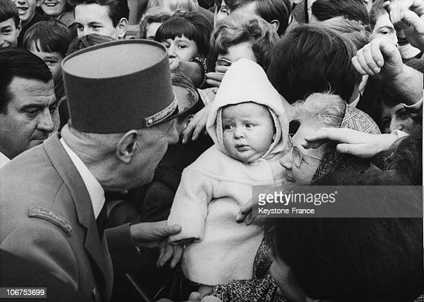 France Strasbourg The General De Gaulle Stopping And Greeting A Baby In The Crowd On November 23Rd 1964