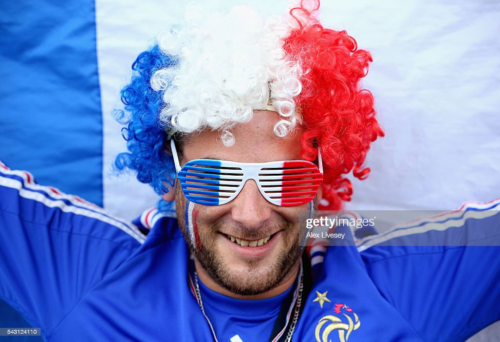 A France supporter poses for photographs prior to the UEFA EURO 2016 round of 16 match between France and Republic of Ireland at Stade des Lumieres on June 26, 2016 in Lyon, France.