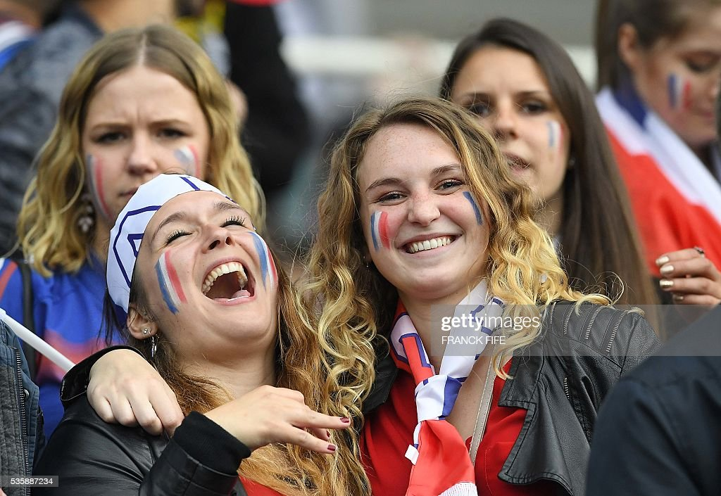 France supporters laugh before the friendly football match between France and Cameroon, at the Beaujoire Stadium in Nantes, western France, on May 30, 2016. / AFP / FRANCK