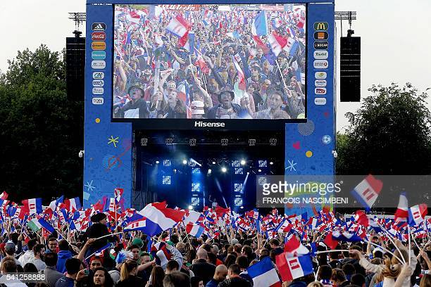 TOPSHOT France supporters react as they watch the Euro 2016 group A football match between Switzerland and France in a fan zone Lille on June 19 2016...