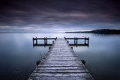France, Symmetrical view of jetty on lake