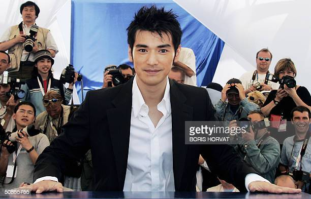 Taiwanese actor Takeshi Kaneshiro poses during a photo call for Chinese director Zhang Yimou's film 'House of Flying Daggers which is being shown out...