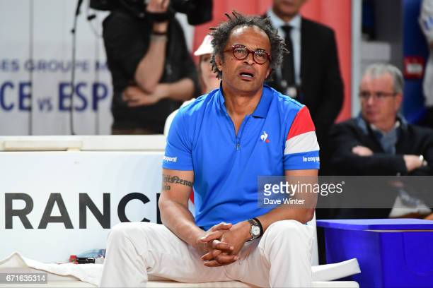 France team captain Yannick Noah reacts to a baby crying in the stands during the Fed Cup match between France and Spain on April 22 2017 in Roanne...