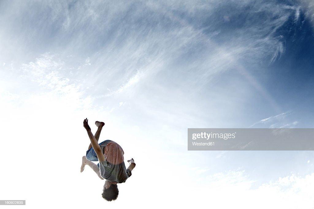 France, Teenage boy jumping