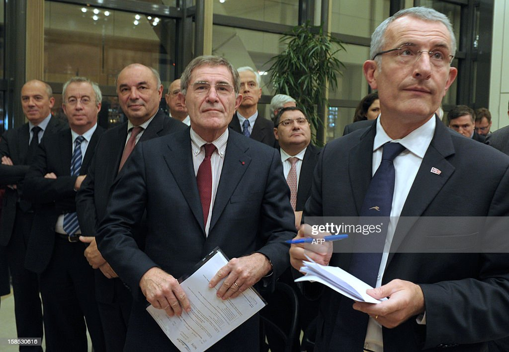 France Telecom head Stephane Richard, Areva head Luc Oursel, La Poste head Jean-Paul Bailly, GDF-SUEZ head Gerard Mestrallet and SNCF head Guillaume Pepy listen prior to sign with other companies' head or representatives, a charter committing their companies to help innovations and to support innovative SMEs in their sector at the French Ministry in Paris on December 18, 2012.