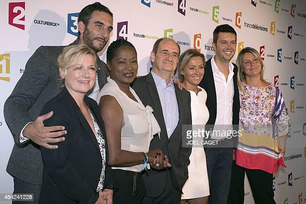 France Televisions host AnneElisabeth Lemoine Matthieu Noel Babette de Rozieres Pierre Lescure AnneSophie Lapix Maxime Switek Luana Belmondo poses...