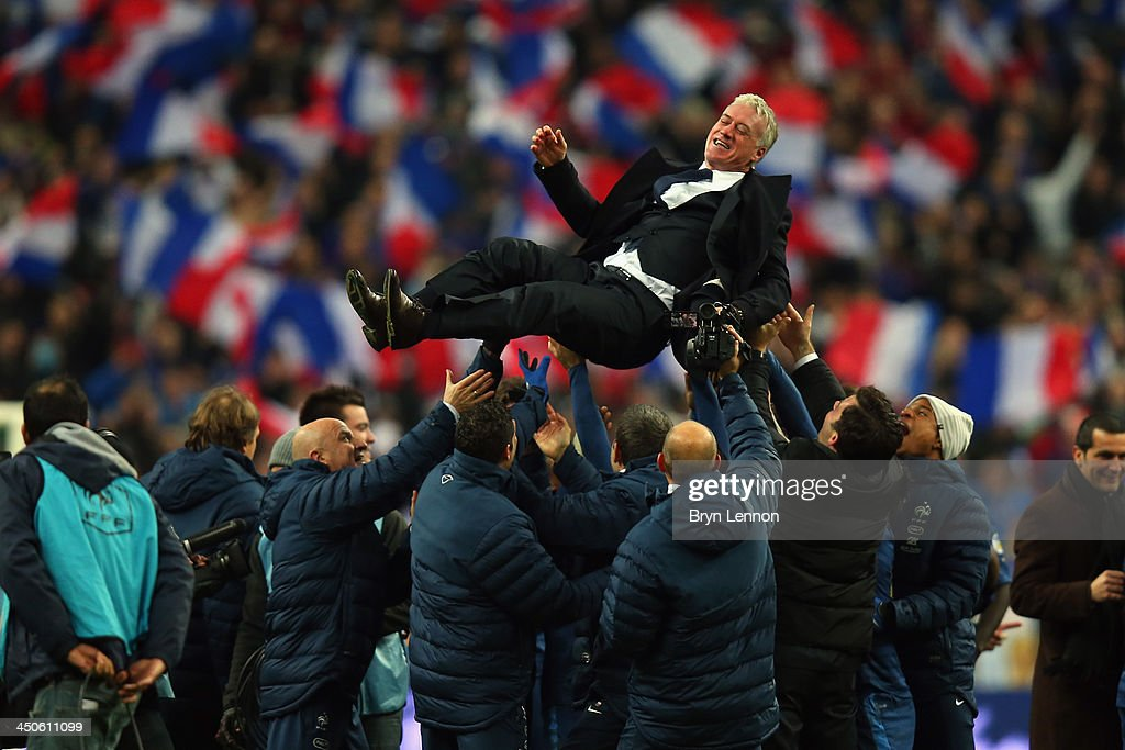France throw their Coach <a gi-track='captionPersonalityLinkClicked' href=/galleries/search?phrase=Didier+Deschamps&family=editorial&specificpeople=213607 ng-click='$event.stopPropagation()'>Didier Deschamps</a> in the air after winning the FIFA 2014 World Cup Qualifier Play-off second leg match between France and Ukraine at the Stade de France on November 19, 2013 in Paris, France.