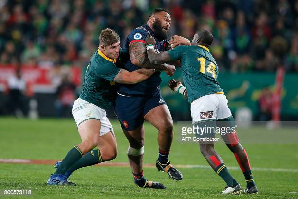 France tight head prop Uini Atonio is tackled by South Africa hooker Malcom Marx and South Africa wing Raymon Rhule during their third rugby union...