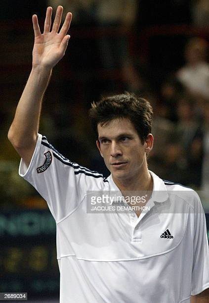 Tim Henman of Great Britain waves to the public after winning against seed number one Andy Roddick of the US after their Paris ATP Masters Series...
