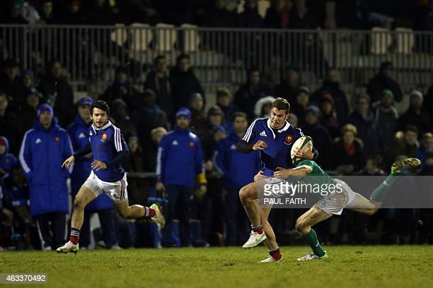 France Under20's Damian Penaud is tackled during the Under 20 rugby union Six Nations Championship match between Ireland and France at Dubarry Park...