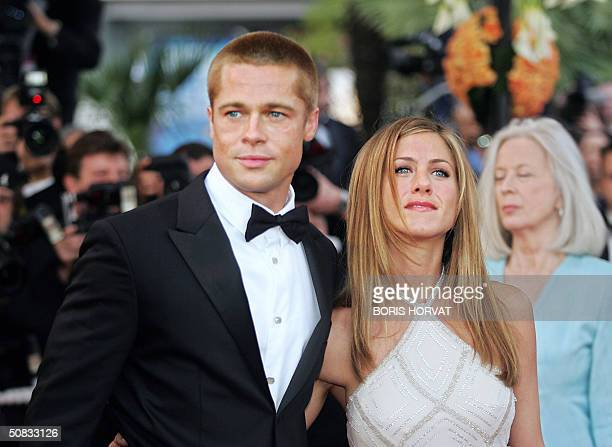 US actor Brad Pitt and his wife Jennifer Aniston arrive for the official projection of US director Wolfgang Petersen's film 'Troy' 13 May 2004 at the...