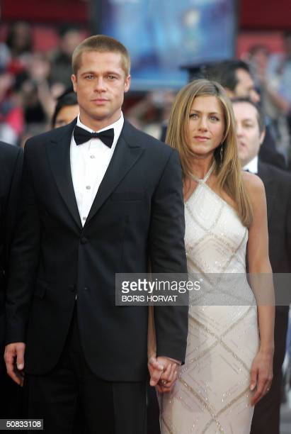 US actor Brad Pitt and his wife Jennifer Aniston arrive to attend the screening of US director Wolfgang Petersen's film 'Troy' 13 May 2004 at the...