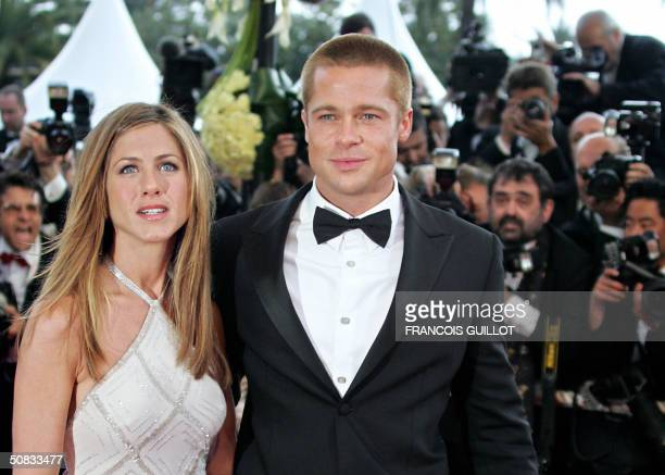 US actor Brad Pitt and his wife Jennifer Aniston arrive to attend the official projection of US director Wolfgang Petersen's film 'Troy' 13 May 2004...