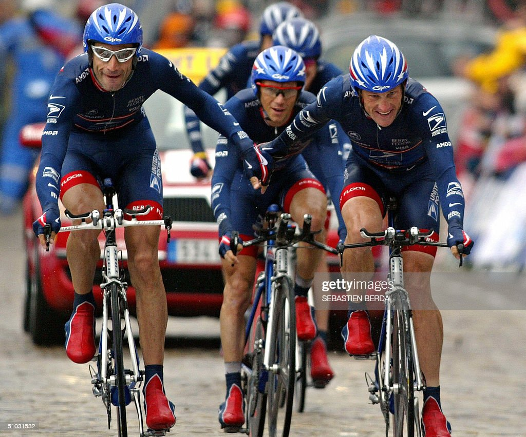 US Lance Armstrong (US Postal/USA) (R) and his teammate George Hincapie hold their hands as they arrive and win the team time trial in the fourth stage of the 91st Tour de France cycling race between Cambrai and Arras, 07 July 2004.