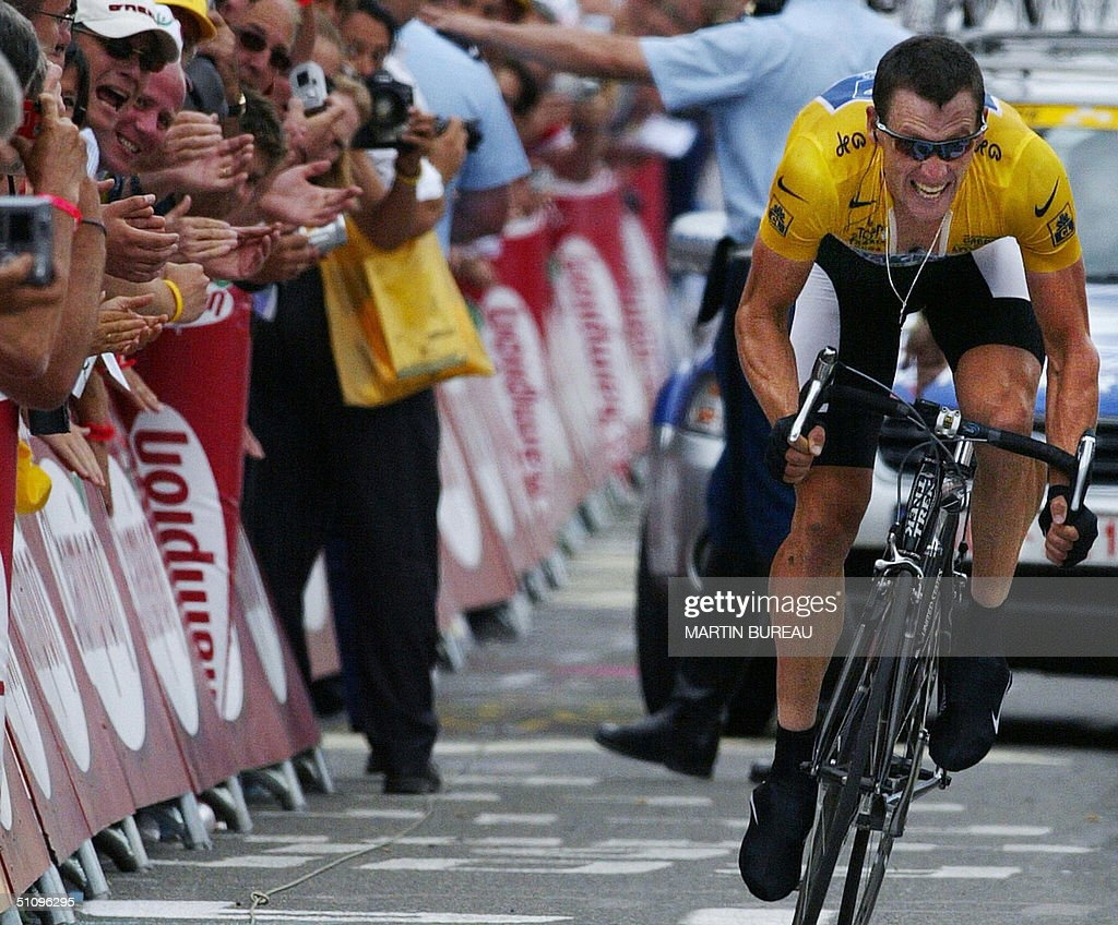 L'ALPE D'HUEZ France US Lance Armstrong crosses the finish line of the 16th stage of the 91st Tour de France cycling race a time trial between Bourg...