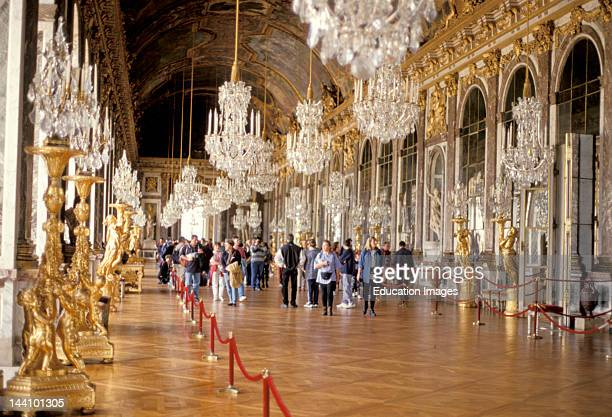France Versailles Chateau De Versailles Hall Of Mirrors Long Hall Of Mirrors And Chandeliers Tourists Looking Around