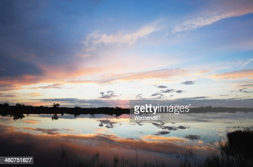 France, View of saltwater lagune at sunset
