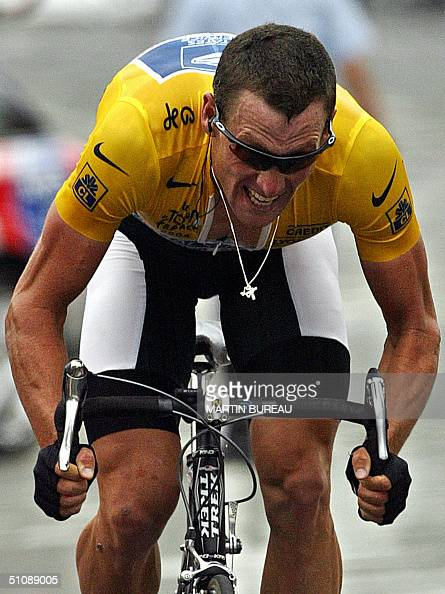 L'ALPE D'HUEZ France Yellow jersey US Lance Armstrong crosses the finish line of the 16th stage of the 91st Tour de France cycling race a time trial...