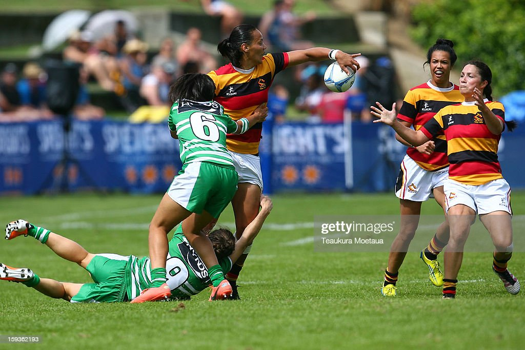 Francea Hansen of Waikato looks to pass against Manawatu during the National Rugby Sevens at the Queenstown Recreation Ground on January 13, 2013 in Queenstown, New Zealand.
