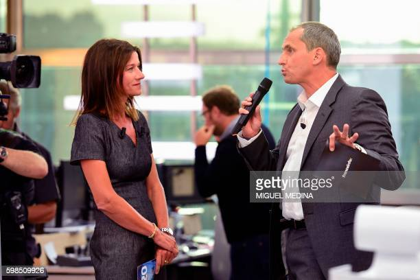 Franceinfo's French journalist Louis Laforge speaks next to Franceinfo's Carole Gaessler and in front of a camera on September 1 prior to the launch...