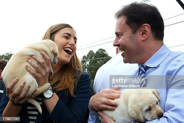Frances Abbott and Liberal MP Josh Frydenberg hold a puppy at Victoria Guide Dogs on September 6 2013 in Melbourne Australia With just one day left...