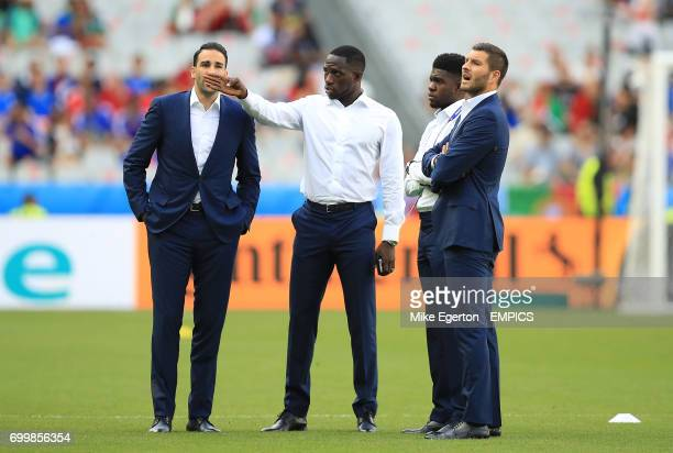 France's Adil Rami Moussa Sissoko Samuel Umtiti and AndrePierre Gignac chat on the pitch before the game