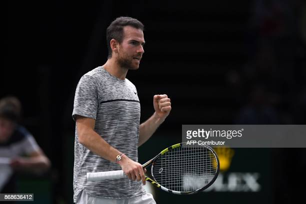 France's Adrian Mannarino celebrates after winning a set against Spain's David Ferrer during their first round match at the ATP World Tour Masters...