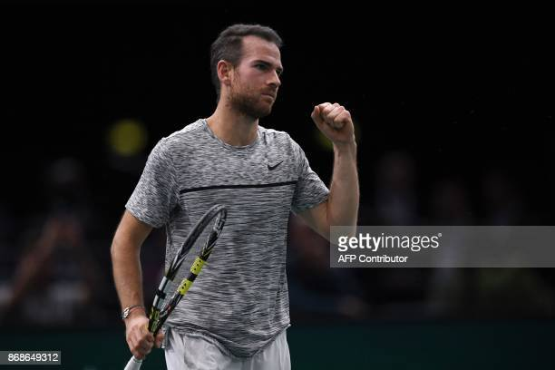 France's Adrian Mannarino celebrates winning against Spain's David Ferrer during their first round match at the ATP World Tour Masters 1000 indoor...
