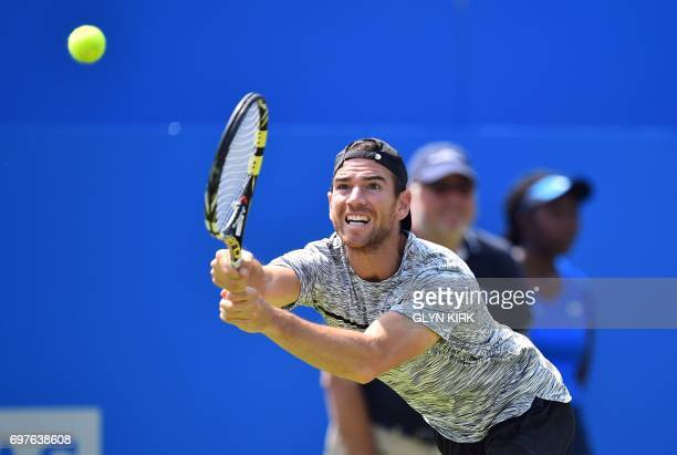 France's Adrian Mannarino returns against France's JoWilfried Tsonga in their men's singles 1st round match at the ATP Aegon Championships tennis...