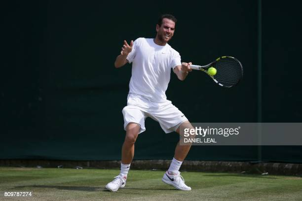 France's Adrian Mannarino returns against Japan's Yuichi Sugita during their men's singles second round match on the fourth day of the 2017 Wimbledon...