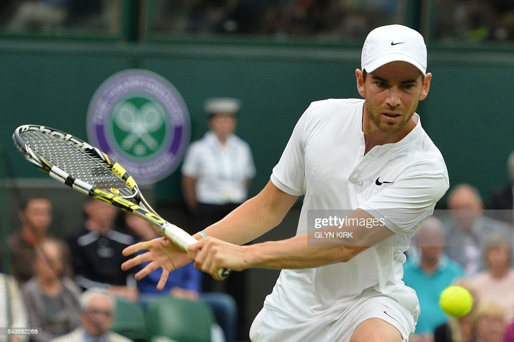 France's Adrian Mannarino returns against Serbia's Novak Djokovic during their men's singles second round match on the third day of the 2016 Wimbledon Championships at The All England Lawn Tennis Club in Wimbledon, southwest London, on June 29, 2016. / AFP / GLYN