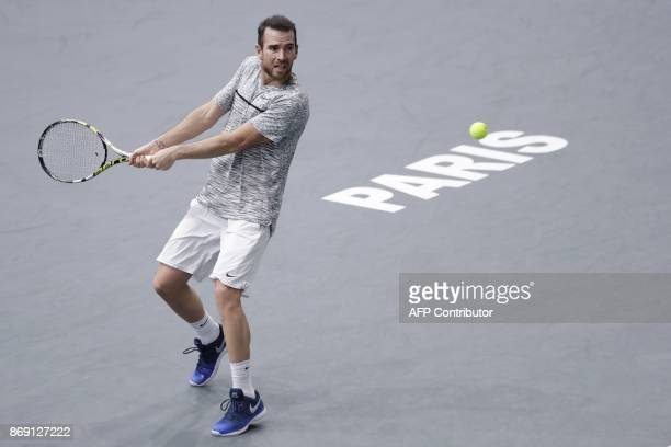France's Adrian Mannarino returns the ball to Belgium's David Goffin during their second round match at the ATP World Tour Masters 1000 indoor tennis...
