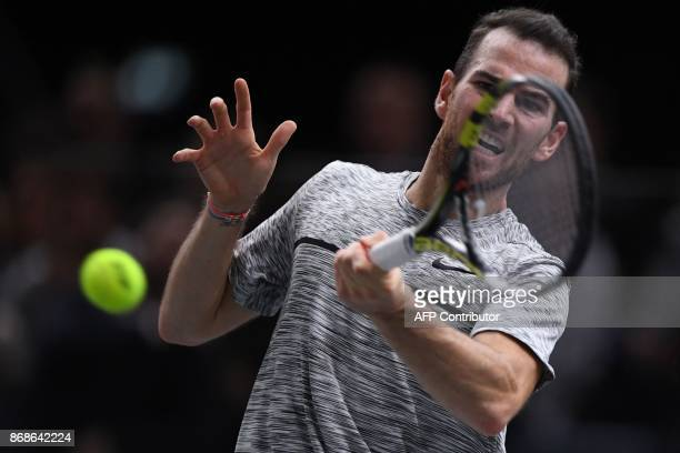 France's Adrian Mannarino returns the ball to Spain's David Ferrer during their first round match at the ATP World Tour Masters 1000 indoor tennis...