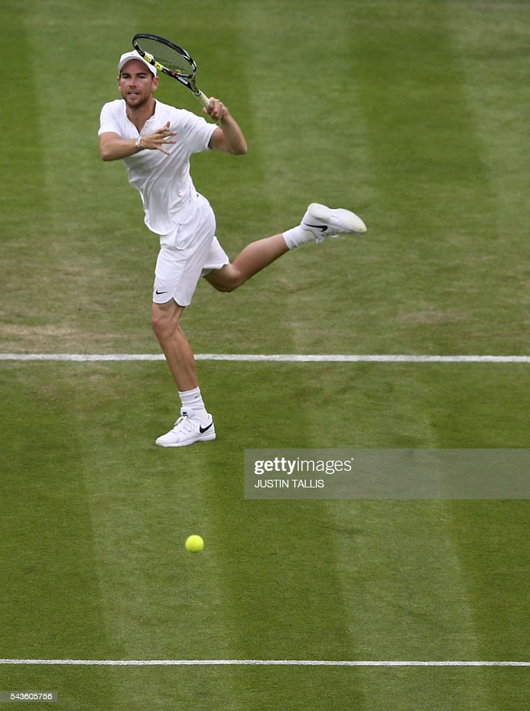 France's Adrian Mannarino returns to Serbia's Novak Djokovic during their men's singles second round match on the third day of the 2016 Wimbledon Championships at The All England Lawn Tennis Club in Wimbledon, southwest London, on June 29, 2016. / AFP / JUSTIN
