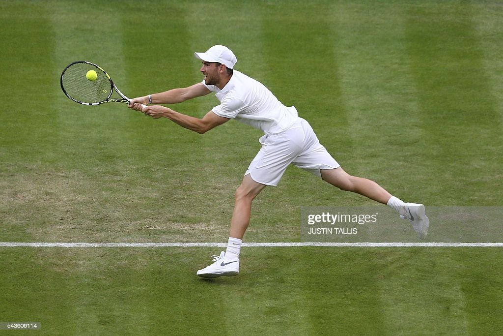 France's Adrian Mannarino serves to Serbia's Novak Djokovic during their men's singles second round match on the third day of the 2016 Wimbledon Championships at The All England Lawn Tennis Club in Wimbledon, southwest London, on June 29, 2016. / AFP / JUSTIN