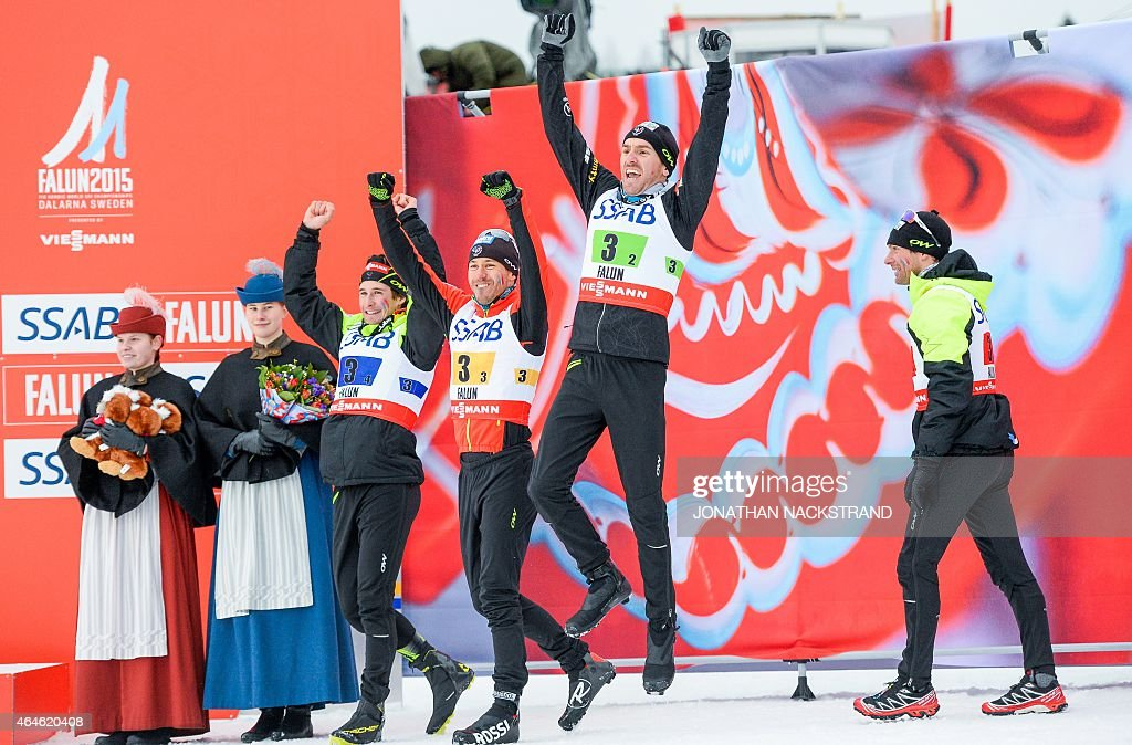 France's Adrien Backscheider, <a gi-track='captionPersonalityLinkClicked' href=/galleries/search?phrase=Robin+Duvillard&family=editorial&specificpeople=6680782 ng-click='$event.stopPropagation()'>Robin Duvillard</a>, <a gi-track='captionPersonalityLinkClicked' href=/galleries/search?phrase=Maurice+Manificat&family=editorial&specificpeople=5632025 ng-click='$event.stopPropagation()'>Maurice Manificat</a> and Jean Marc Gaillard react during the winners ceremony after placing third in the men's 4x10 km cross-country relay at the 2015 FIS Nordic Skiing World Championships in Falun, Sweden, February 27, 2015. AFP PHOTO / JONATHAN NACKSTRAND