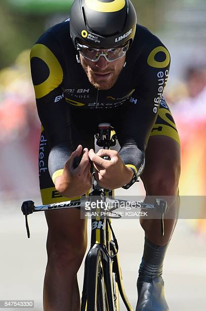 France's Adrien Petit crosses the finish line of the 375 km individual timetrial the thirteenth stage of the 103rd edition of the Tour de France...