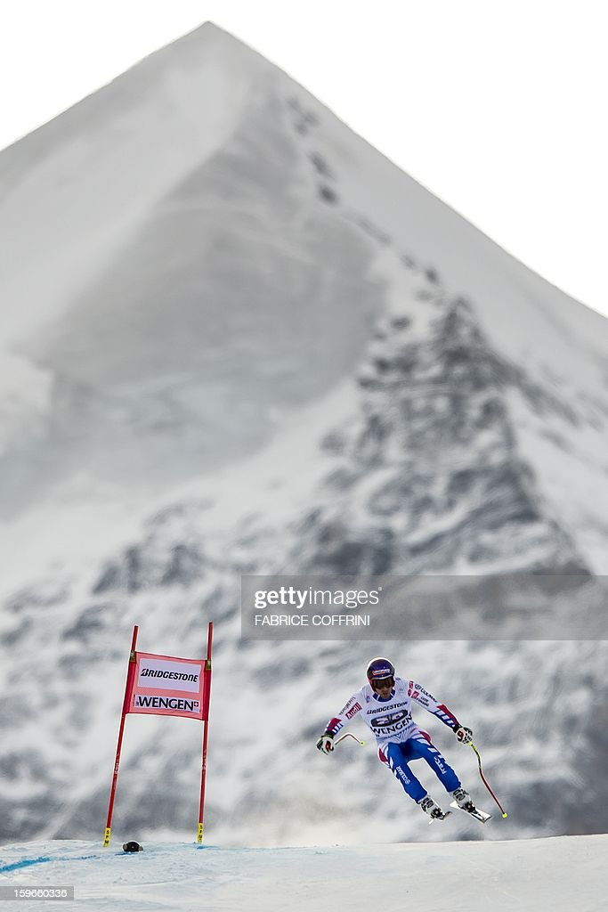 France's Adrien Theaux leaps on January 18, 2013 in front of the Silberhorn mountain during the downhill event of the men's super combined of the FIS Alpine Skiing World Cup in Wengen.