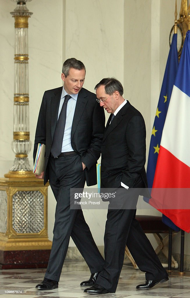 France's Agriculture, Food, Fisheries and Land Management Minister <a gi-track='captionPersonalityLinkClicked' href=/galleries/search?phrase=Bruno+Le+Maire&family=editorial&specificpeople=877418 ng-click='$event.stopPropagation()'>Bruno Le Maire</a> (L) and France's Interior Minister <a gi-track='captionPersonalityLinkClicked' href=/galleries/search?phrase=Claude+Gueant&family=editorial&specificpeople=861764 ng-click='$event.stopPropagation()'>Claude Gueant</a> leave the weekly cabinet meeting at Elysee Palace on March 9, 2011 in Paris, France.