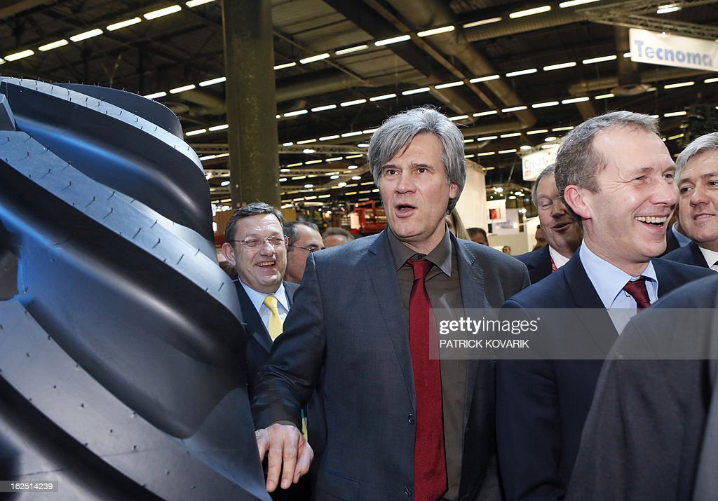 France's Agriculture Minister Stephane Le Foll (C) and France's Junior Minister for Food Industry Guillaume Garot (R) react as they visit the Paris International Agri-business Show (SIMA), which is part of the yearly International Agriculture Fair of Paris, on February 24, 2013, in Villepinte, a Paris suburb. The events runs from February 23 to March 3, 2013.