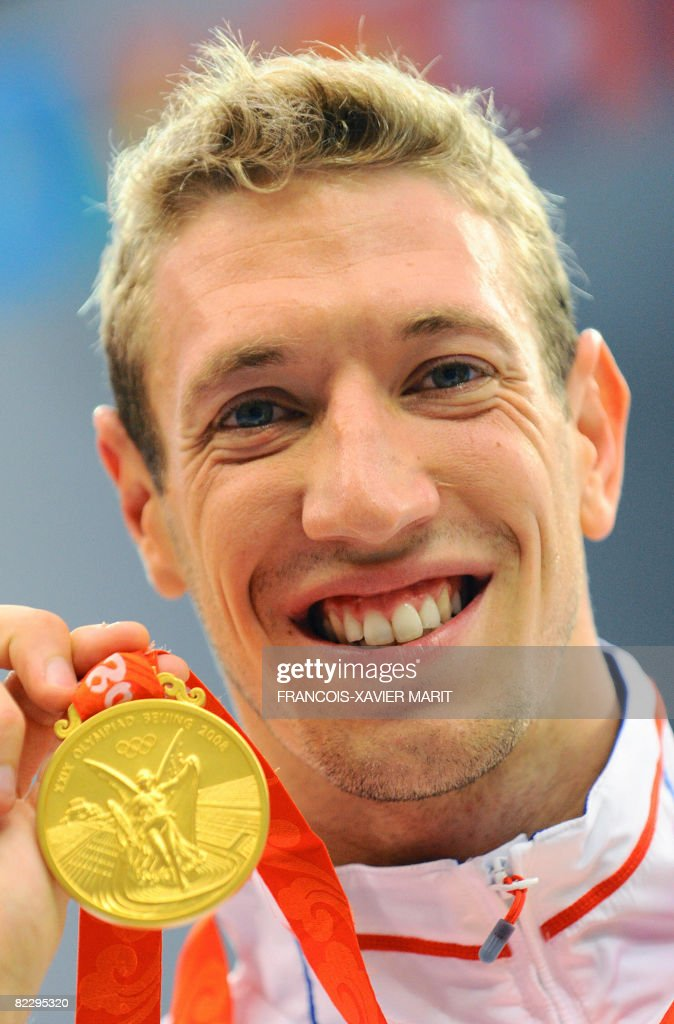 France's <a gi-track='captionPersonalityLinkClicked' href=/galleries/search?phrase=Alain+Bernard+-+Nadador&family=editorial&specificpeople=775873 ng-click='$event.stopPropagation()'>Alain Bernard</a> poses with his medal for the men's 100m freestyle swimming final at the National Aquatics Center during the 2008 Beijing Olympic Games in Beijing on August 14, 2008. Bernard won the men's 100m freestyle gold medal at the Beijing Games, overtaking Eamon Sullivan on the closing length to triumph over the Australian world record holder. Bernard won in 47.21sec, with Sullivan second in 47.32. AFP PHOTO / FRANCOIS-XAVIER MARIT